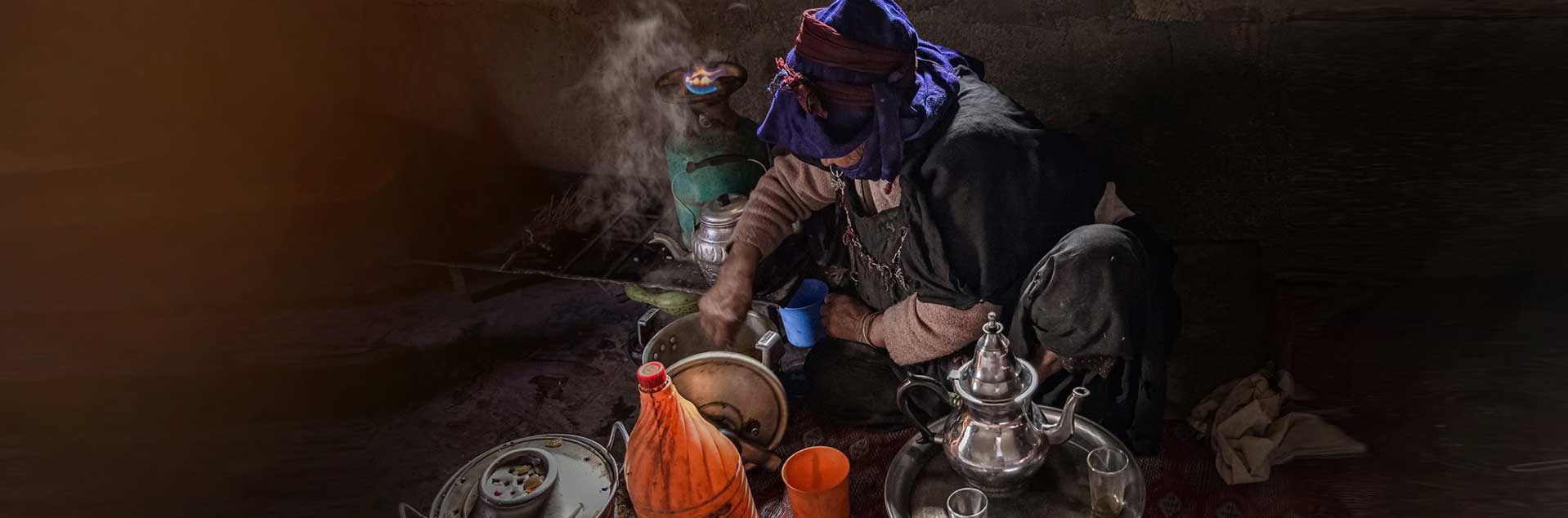 Header photo of a man making tea in Morocco